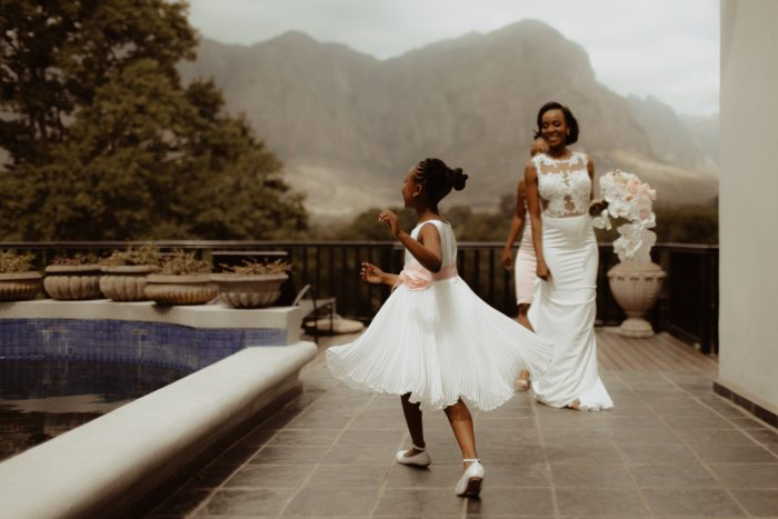 flower girl running next to bride