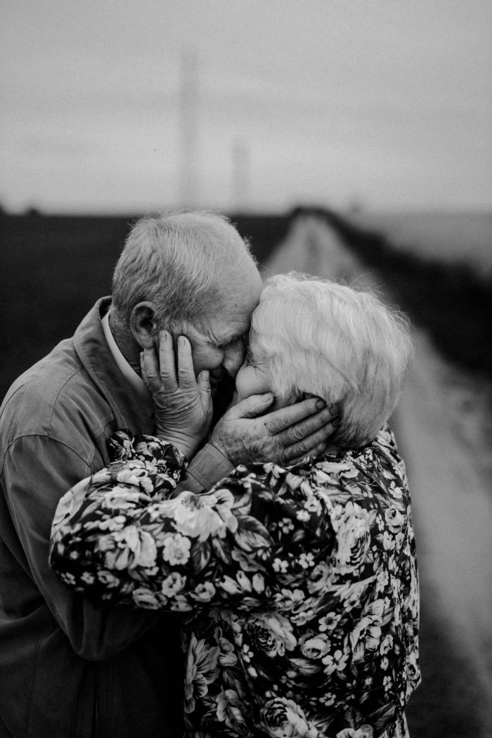 elderly couple embracing black and white