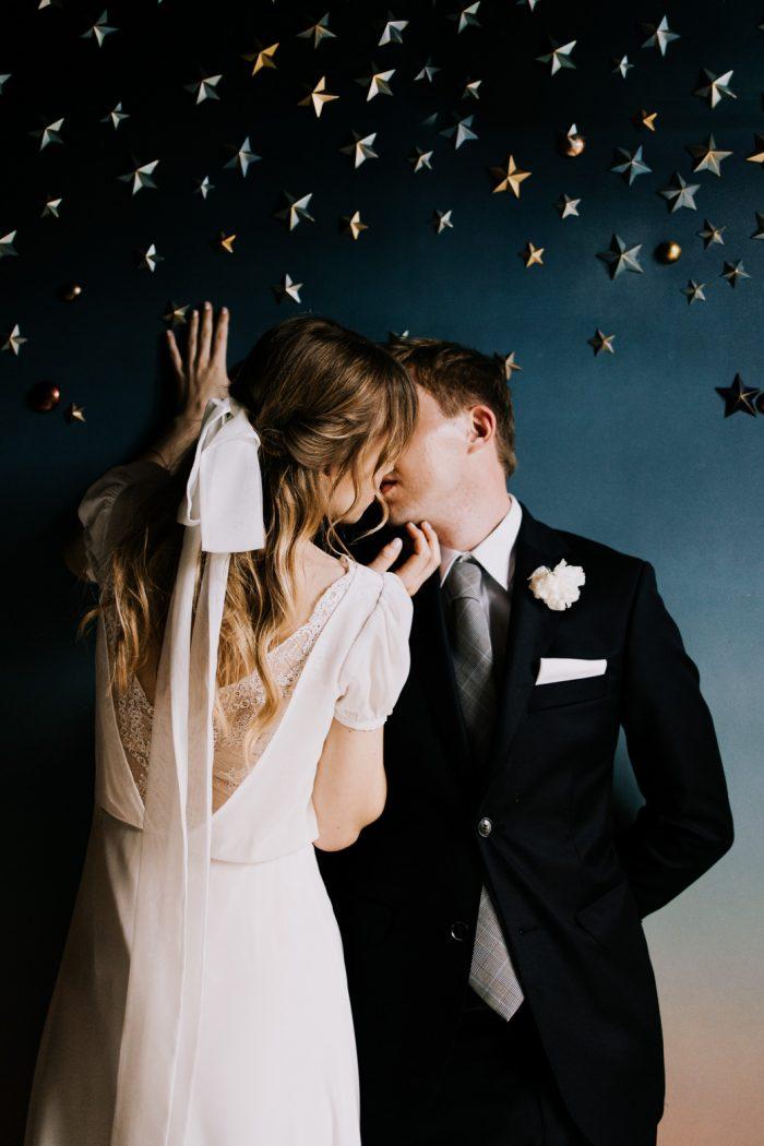 stylish couple on starry wall