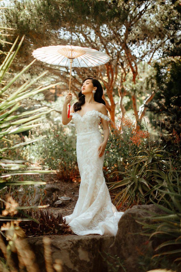 bride with umbrella in garden