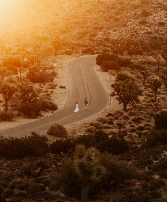 sunset photo couple walking down road
