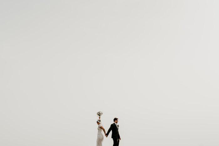 wedding day couple white sky