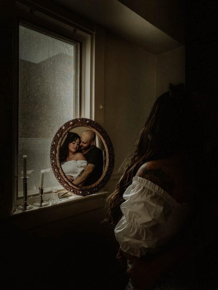 couple portrait framed in mirror