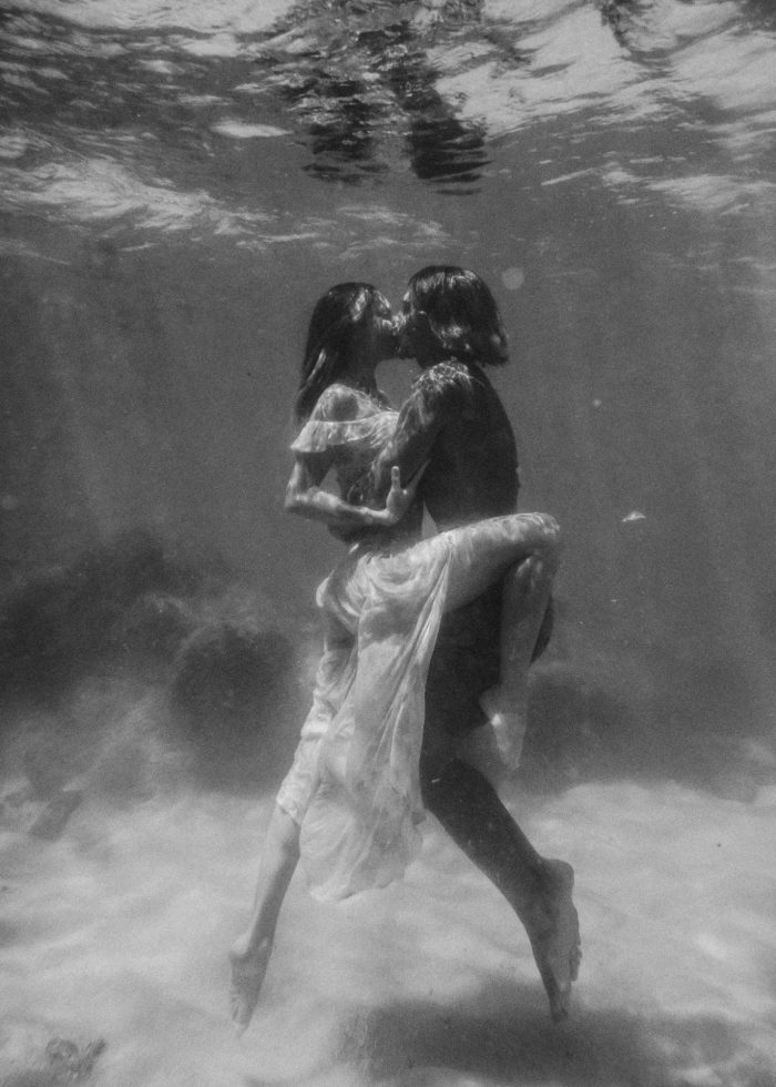 black and white underwater couple
