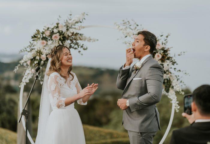 funny ceremony shot of groom using breath freshener