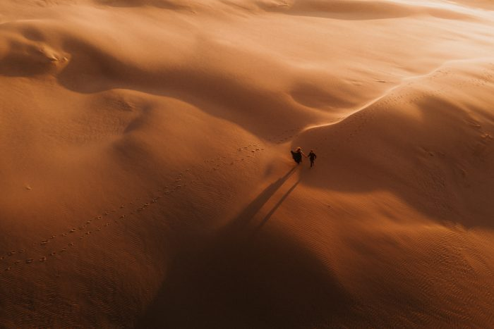 drone shot of couple in desert sands