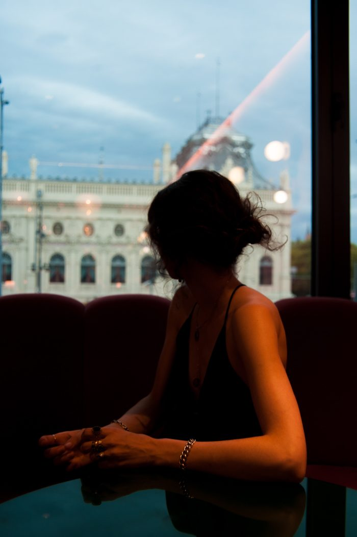 create for yourself photo of woman looking out the window