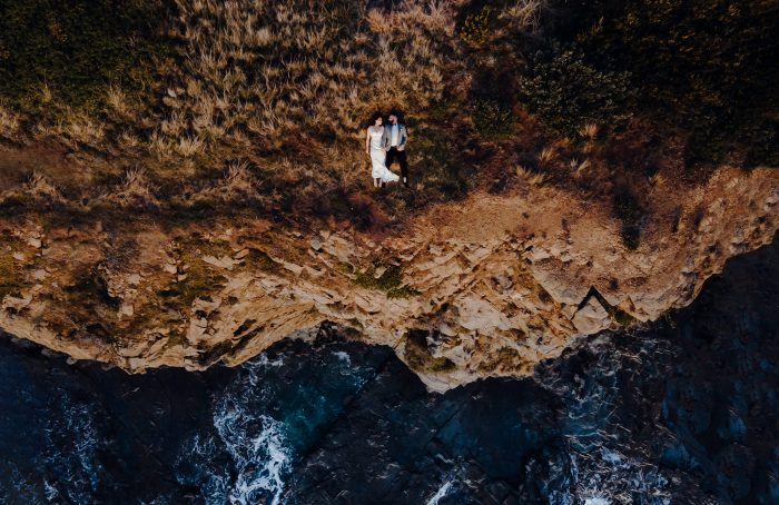 drone shot wedding day couple by the ocean