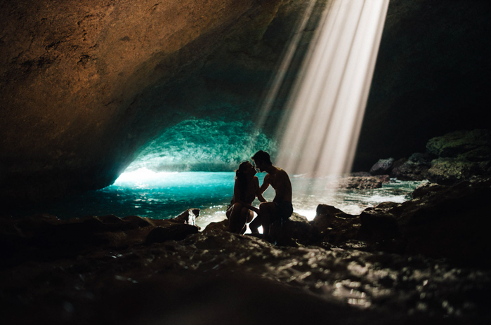couple in cave with sunlight peeking