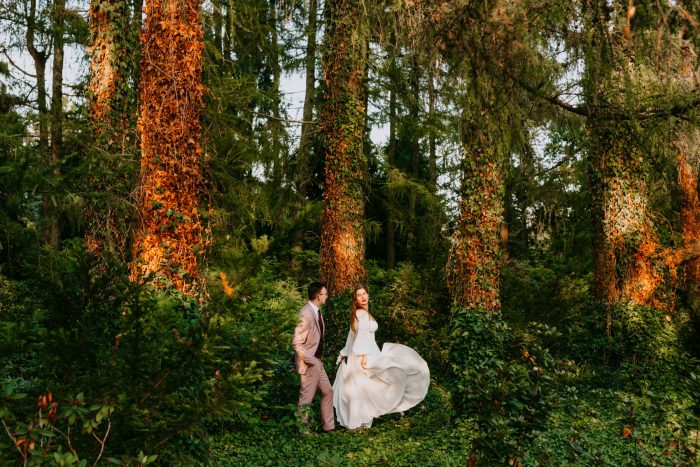 couple walking through woods September 2021
