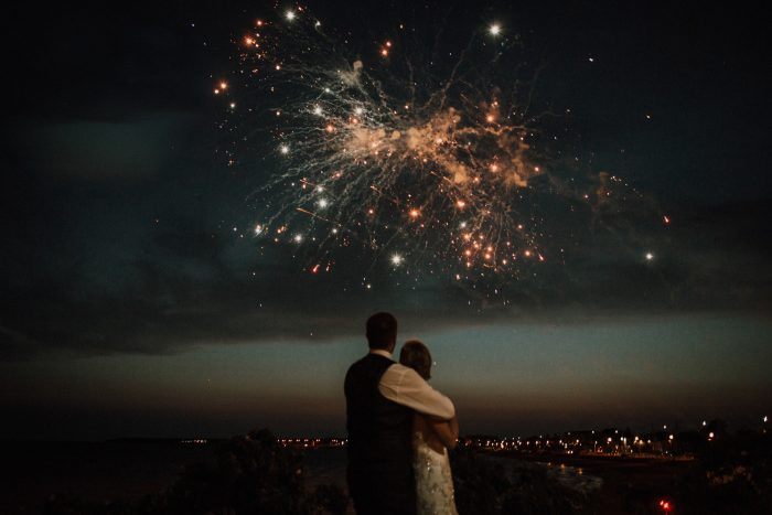 married couple watching fireworks