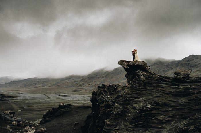 Couple portrait in Iceland among black rock