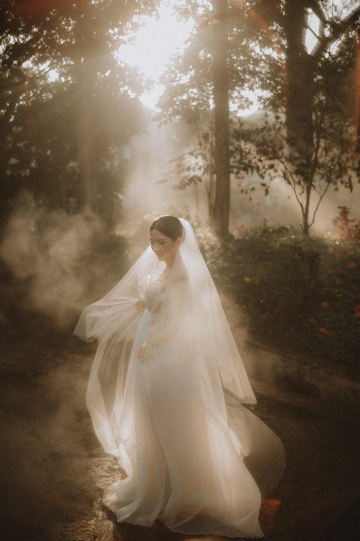 moody bridal portrait with fog 2021