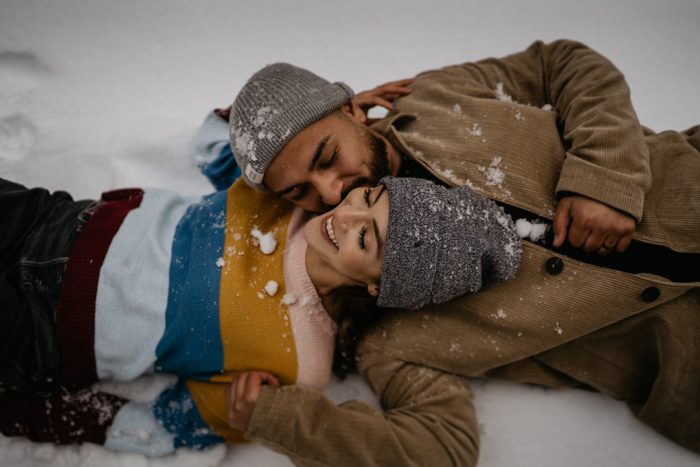 couple in snow winter wedding outfit guide